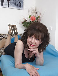 Hairy mature beeglady playing with her toy boy